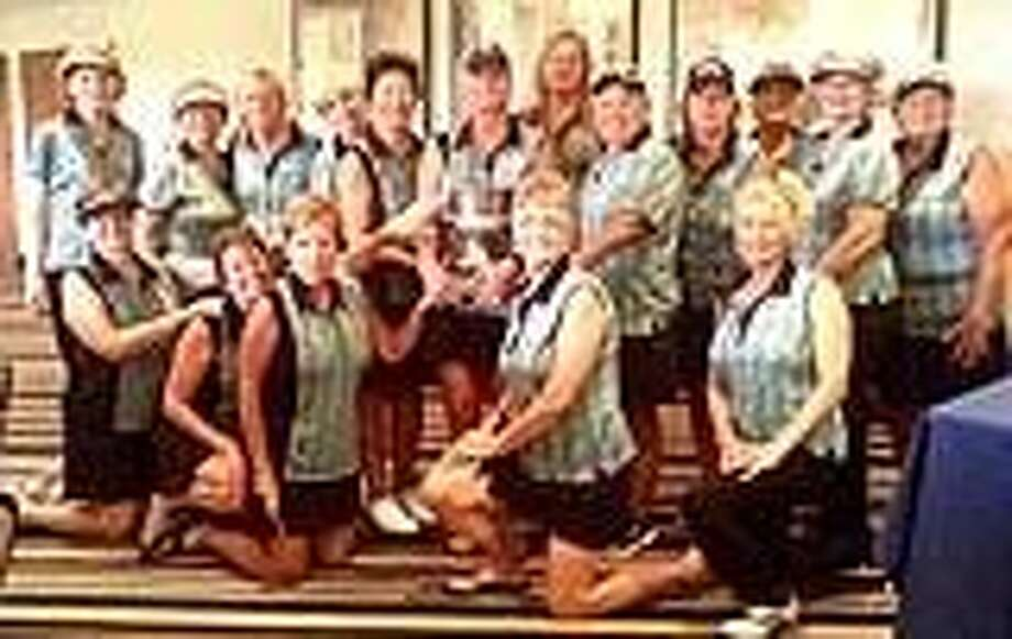 Members of the team are: (front row kneeling: Nancy Kelly, Toni Sonnega, Peggy Chapman, Glendean Henderson and Patty Parker. (Back row standing) Neoma Landriault, Pat Winterrowd, Linda Laidlaw, Nancy Jordan, Interclub President Sharon Dott, Lady Swingers President Jo Johnson, Carrie Baker, Bobbie Hill, Tina Buantello, Sharon Rainer, Jenny Bussey, Judy Brown. Not pictured but among the winners: Mary Nevis, Connie Tate, Diane Taylor, Annette Kenyon, Karen Jones, Carolyn Summers, Monica Graham, Carol Happel and Jean Wood.