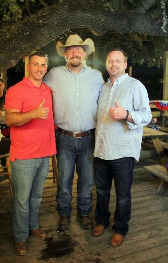 Pearland Councilmembers Greg Hill (left) and Keith Ordeneaux (right) visit with newly-elected Brazoria County Commissioner Ryan Cade (center) on election night. Photo: Kristi Nix