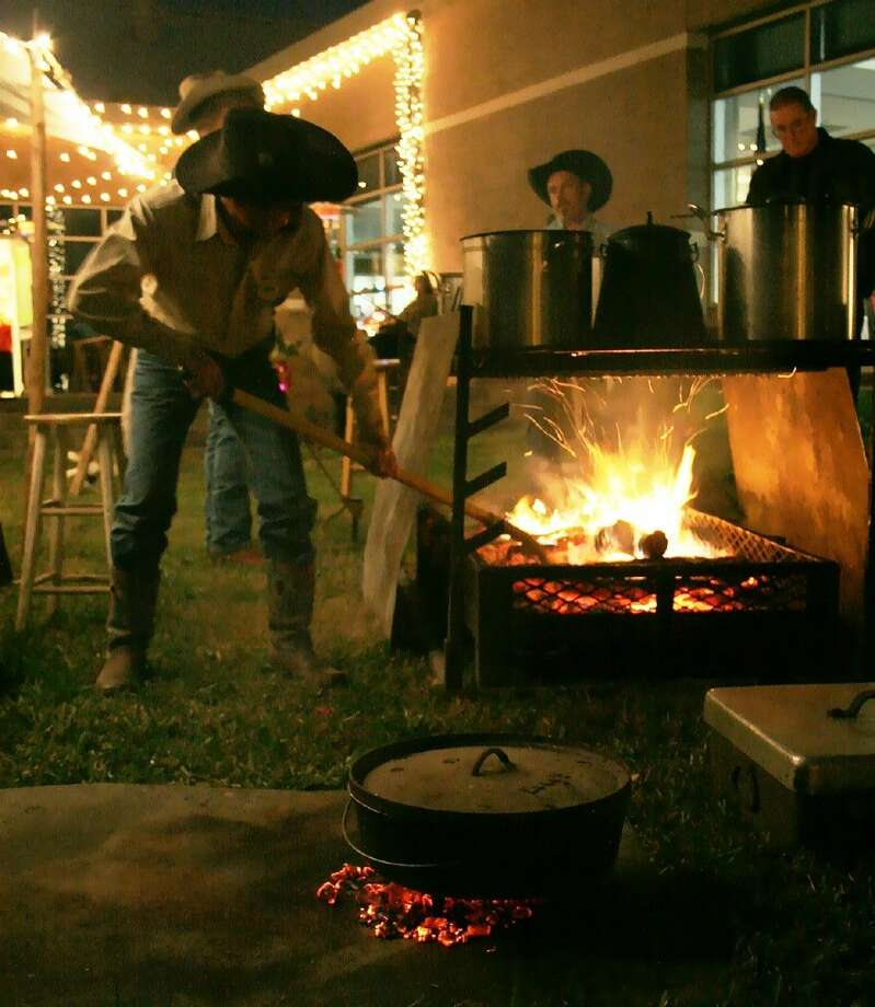 Buck Reams and the Chuckwagon Cookers prepare the dinner for a recent Foundation Christmas Gala.