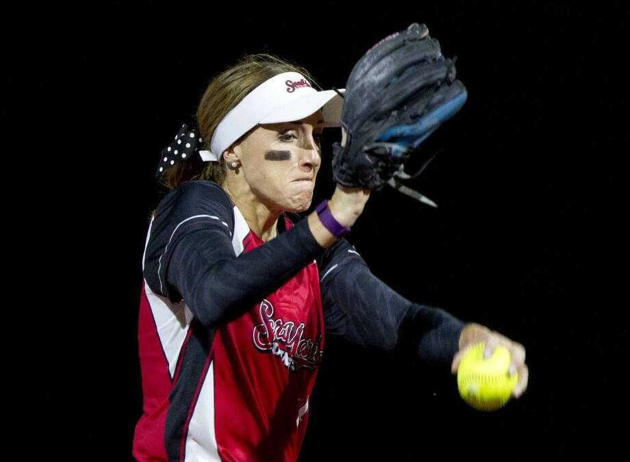 Scrap Yard Dawgs pitcher Monica Abbott delivers a pitch on Friday.