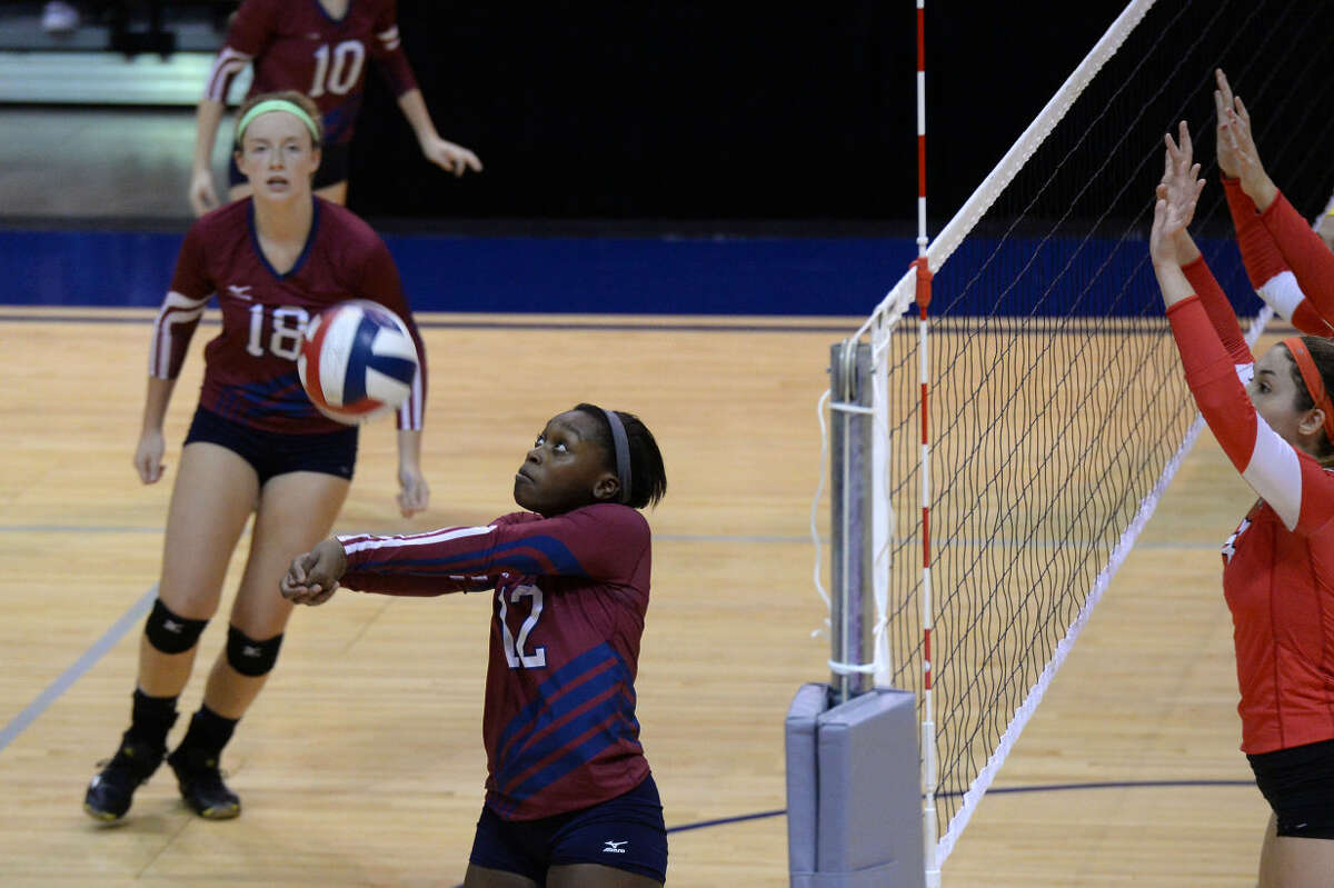 Tompkins setter Kailyn O'Neal passes against Katy during their District 19-6A fourth-place playoff Oct. 30 at the Merrell Center in Katy. To view or purchase this photo and others like it, visit HCNpics.com.