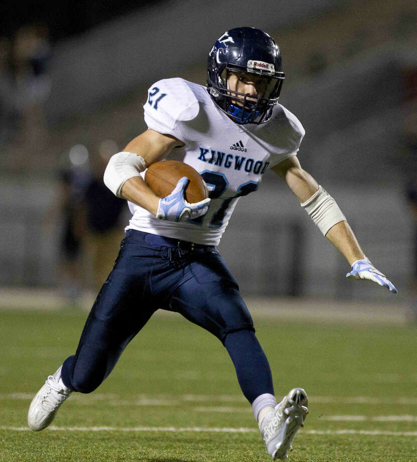 Kingwood's Griffin Lay runs for a first down during a District 16-6A football game Friday. To view or purchase this photo and others like it, visit HCNpics.com. Photo: Jason Fochtman