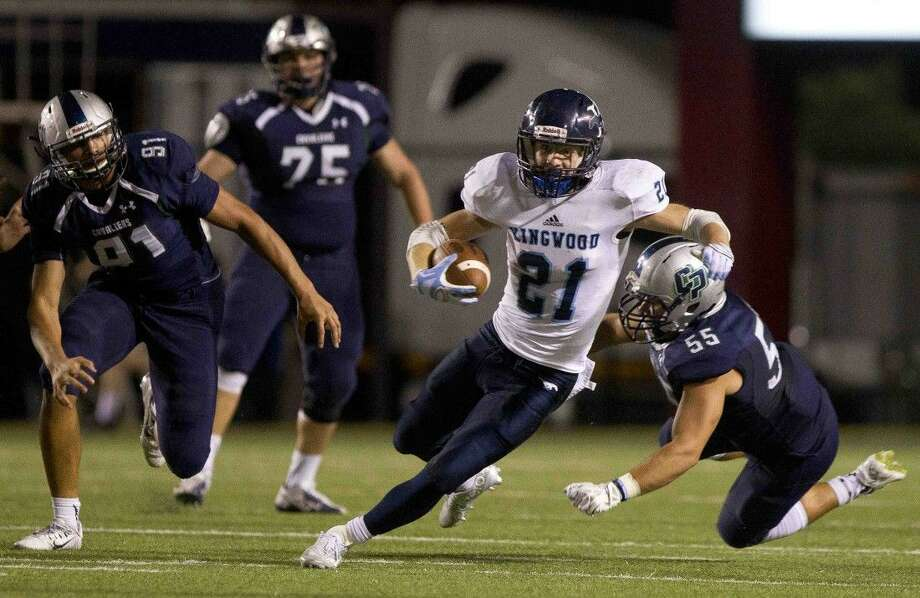 Kingwood's Griffin Lay gets past several College Park defenders during a District 16-6A football game Friday.