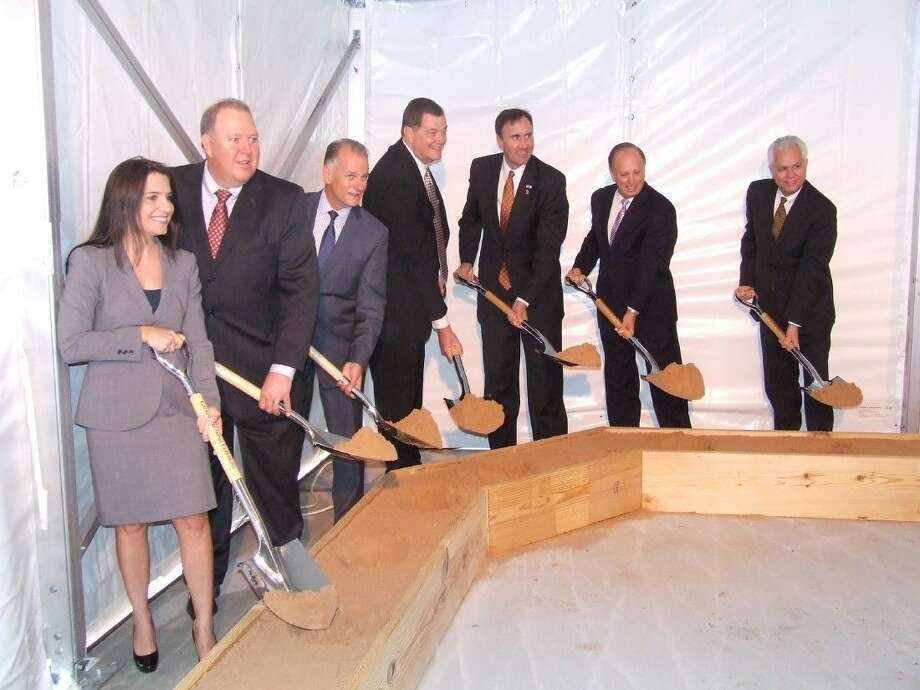 Jennifer Zimmerman (left), chief operations officer of Memorial Hermann Medical Group;Marshall Heins, chief facility services officer of Memorial Hermann Health System; David James, M.D., chief executive officer of Memorial Hermann Medical Group; Scott Barbe, chief executive officer of Memorial Hermann Cypress Campus; Congressman Pete Olson; Dan Wolterman, chief executive officer of Memorial Hermann Health System; Rod Brace, chief regional operations officer of Memorial Hermann Health System. Photo: Alex Endress