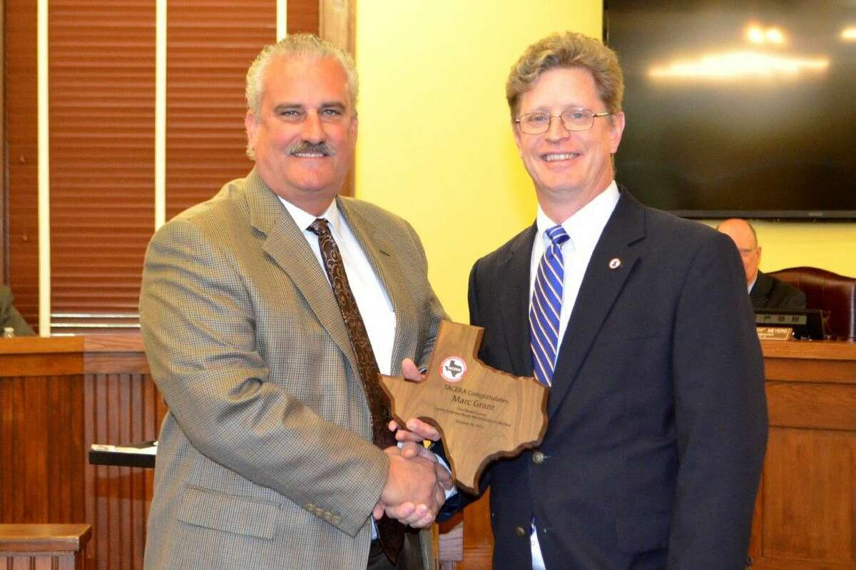 Michael Shannon of TACERA (left) and Fort Bend County Road and Bridge Commissioner Mark Grant.