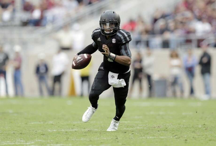 Texas A&M quarterback Kyler Murray runs in the open field against South Carolina during the second half Saturday in College Station.