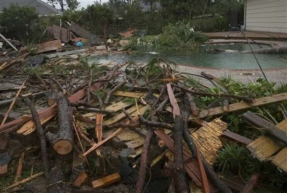 Debris is strewn across the backyard of a Friendswood, Texas home after a tornado reportedly touched down early Saturday. Photo: Stuart Villanueva