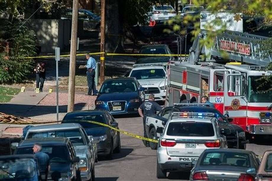 Police investigate the scene after a shooting Saturday, in Colorado Springs, Colo. Multiple are dead, including a suspected gunman, following a shooting spree according to authorities. Lt. Catherine Buckley said the crime scene covers several major downtown streets. Photo: Christian Murdock