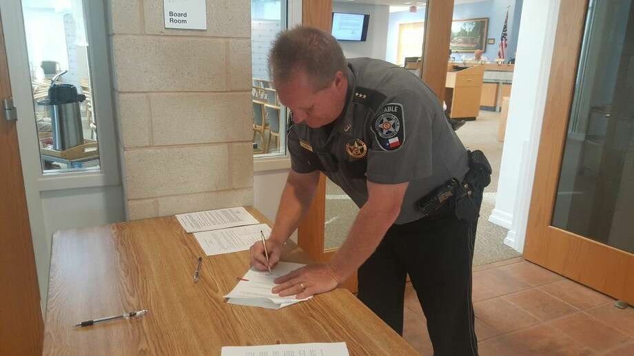 Chief Deputy Barry Welch signs documents officially accepting the EMCID emergency grant to fund flood rescue equipment Thursday, June 9.