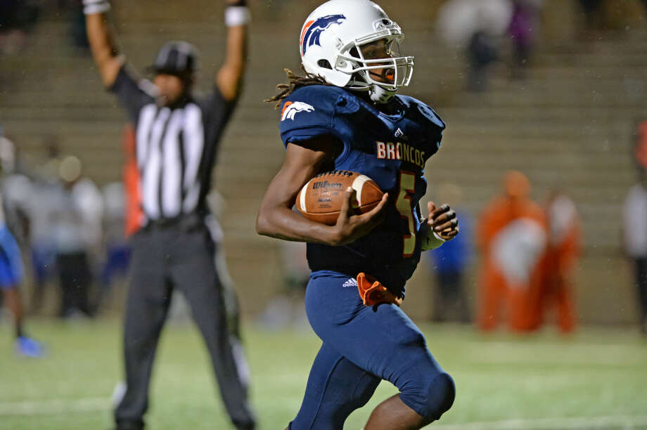Bush quarterback Wade Freeman scores the final touchdown in a 13-9 victory against Elkins, Oct. 31 at Mercer Stadium in Sugar Land. The Broncos improved to 3-3 in District 23-5A, tied with Ball for the final playoff spot. To view or purchase this photo and others like it, visit HCNpics.com. Photo: Craig Moseley