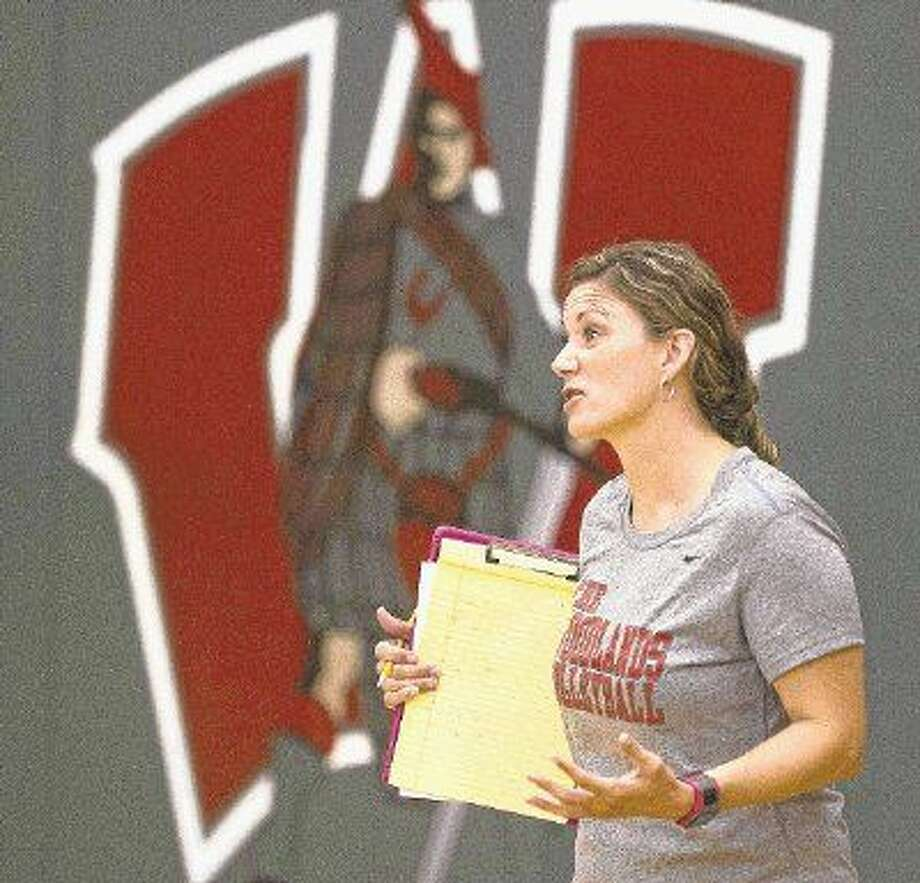 The Woodlands coach Terri Wade returns to her old stomping grounds, Montgomery High School, in the Class 6A volleyball playoffs on Monday night.