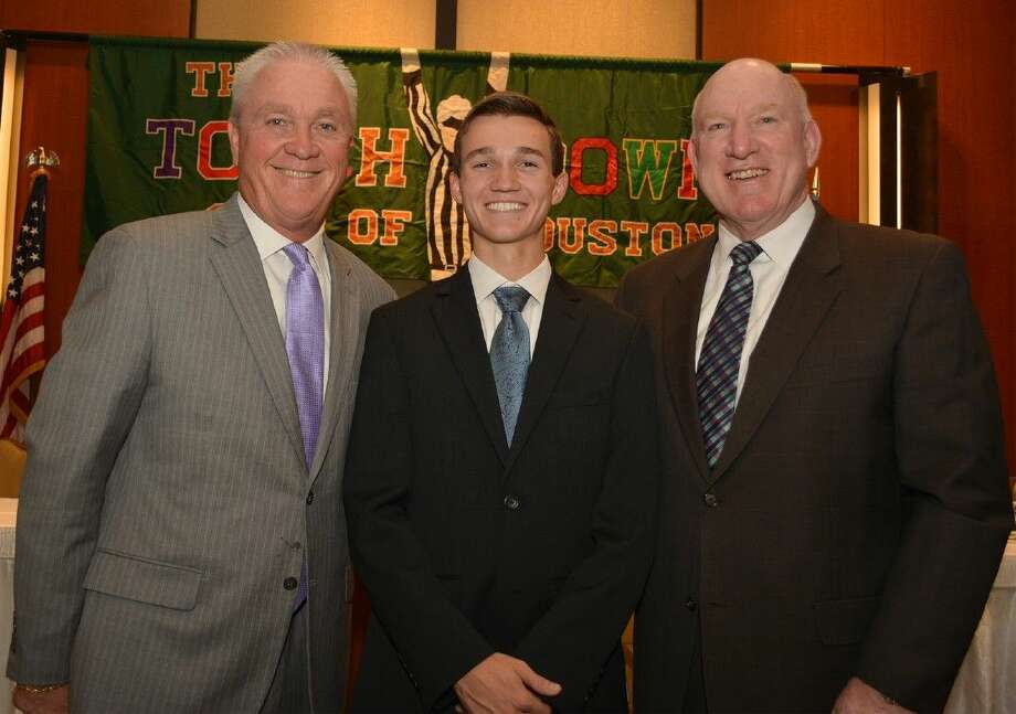 Jersey Village High School senior Mitchell Fly placed second for the Touchdown Club of Houston's 16th Annual High School Football Scholar Athlete Award during the Nov. 12 luncheon at the JW Marriott. Pictured with Fly are head football coach and campus athletic coordinator David Snokhous, left, and Jersey Village Principal Ralph Funk.
