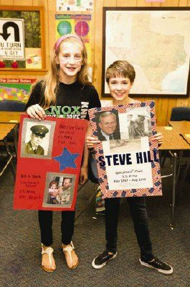 Tommie Anne Stark (left) and Abby Hill (right) are seventh graders at Knox Junior High. They both honored their grandfathers, and Tommie Anne honored her father as well. Posters will be on display outside at Knox the week of Veterans Day, starting Nov. 10. Photo: Michael Minasi
