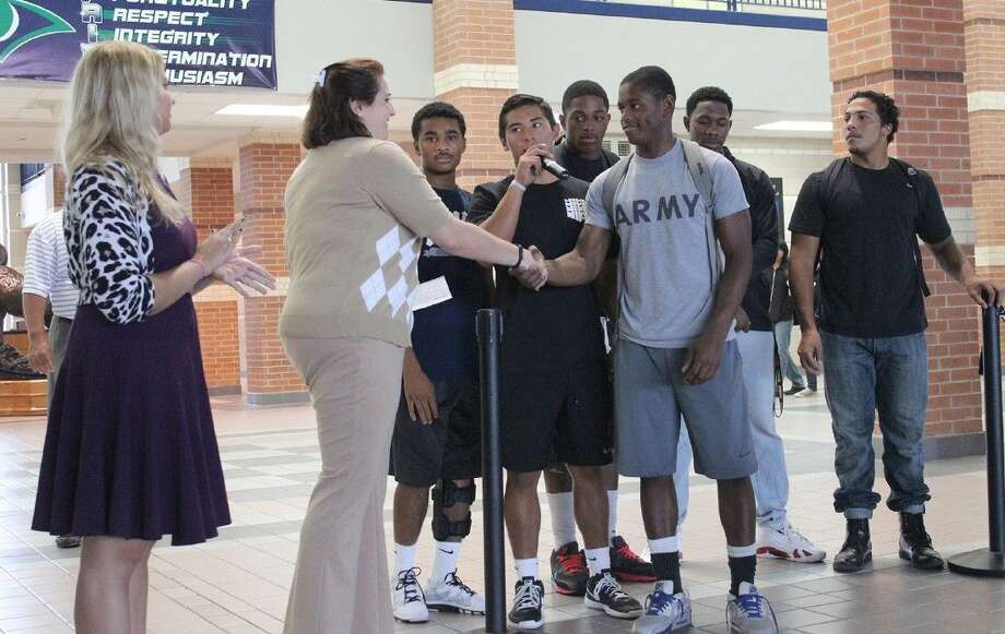 American Cancer Society representative, Heather Hamilton, thanks the Cypress Ridge football team for their donation to the ACS. Photo: Submitted Photo