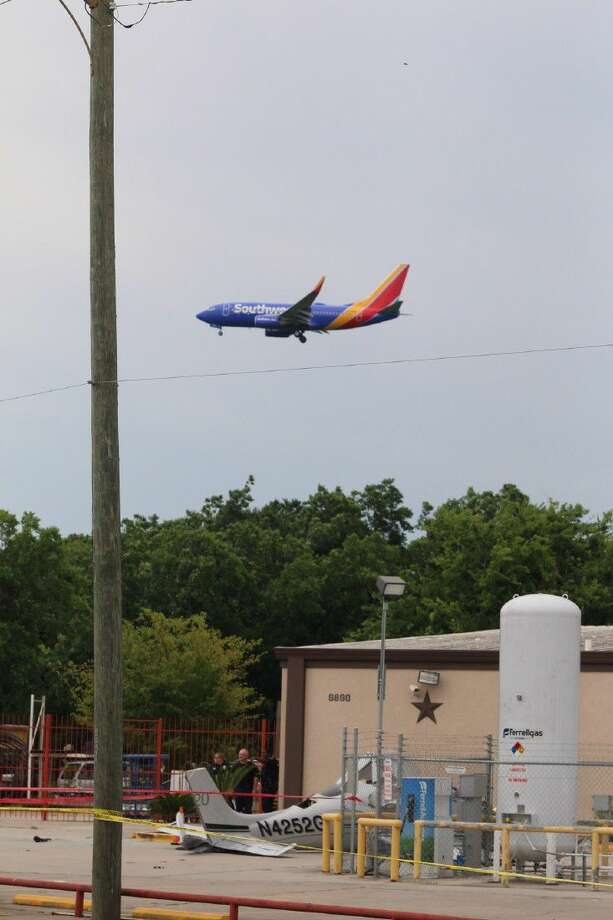 A Southwest Airlines plane passes overhead of the crash site off Telephone Road.
