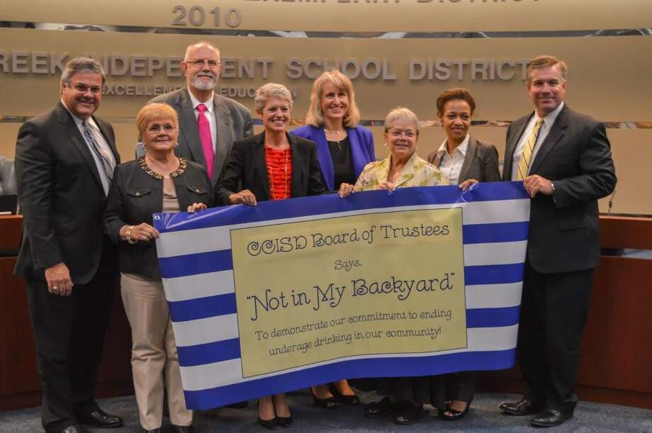 Pictured from left, back row: Dr. Greg Smith, CCISD Superintendent and CCISD Trustees Charles Pond, Laura DuPont, Page Rander and Ken Baliker. Front row, from left: Dee Scott, Win Weber and Ann Hammond. Photo: Clear Creek ISD Office Of Commun