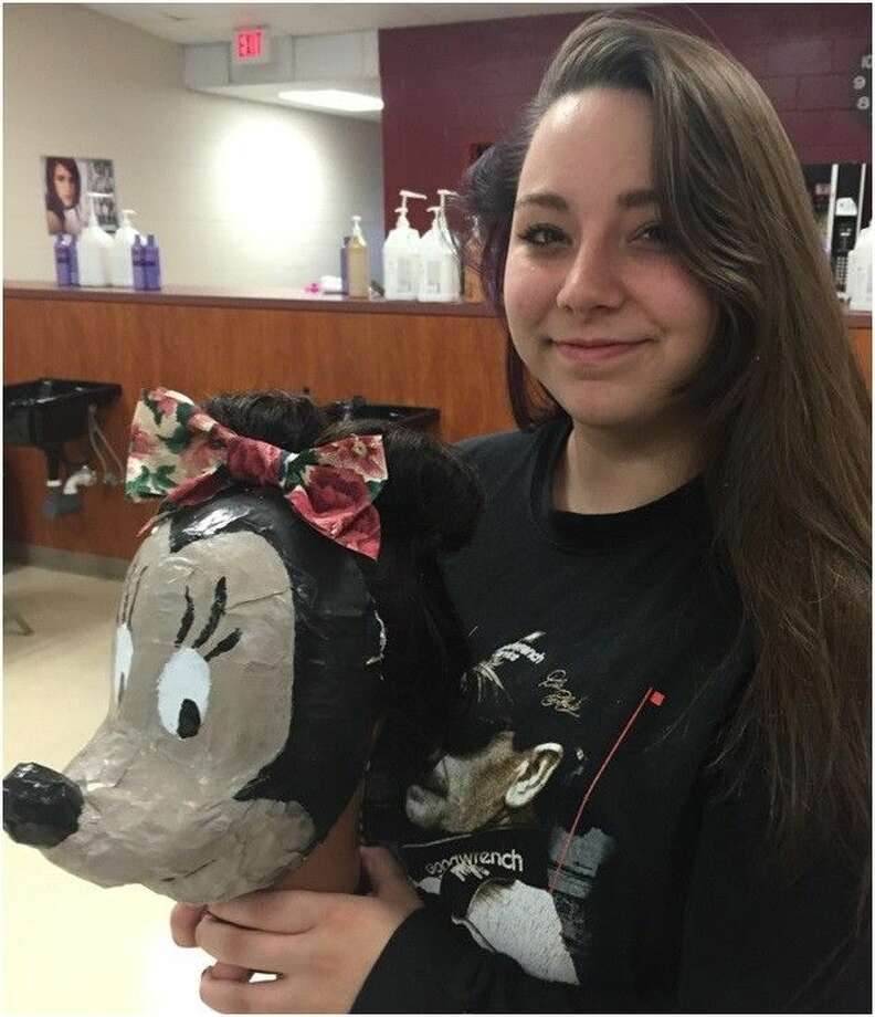 Stormi Everett who created a paper mache Mickey Mouse. Stormi used water, flour, and newspaper to form the face, fingernail polish for the black paint, White-Out for the white areas and gray spray paint.