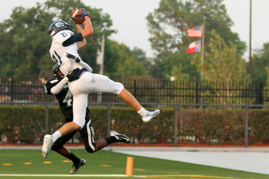 Clements senior Luke Mayock, pictured making a catch against Pasadena Memorial in 2013, was voted Touchdown Club of Houston Scholar-Athlete of the Year. Photo: Pasadena ISD