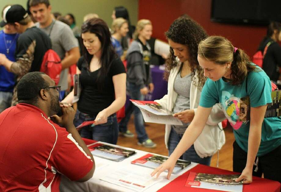 Students speak with a college recruiter during ACC University Day on November 11.