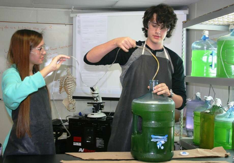 Splendora High School students Addyson Angers and Caleb Enix work in the district's biotechnology lab, which works to produce and study algae. Photo: Stephanie Buckner