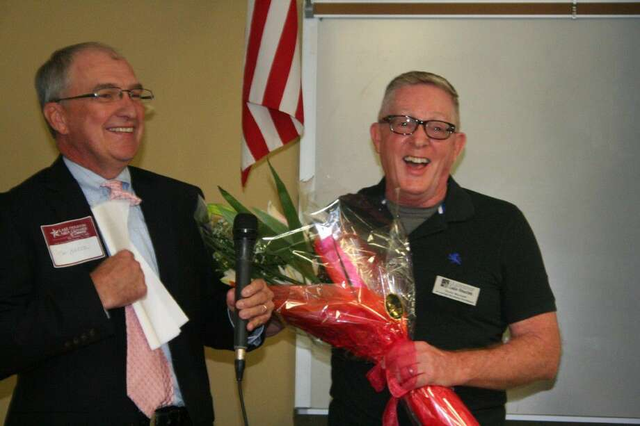 Tim Baker with the Northeast Hospital Foundation, left, surprised Tom Broad with the announcement that he and Nancy Allen, were selected as the honorees of this year's annual In the Pink of Health luncheon.
