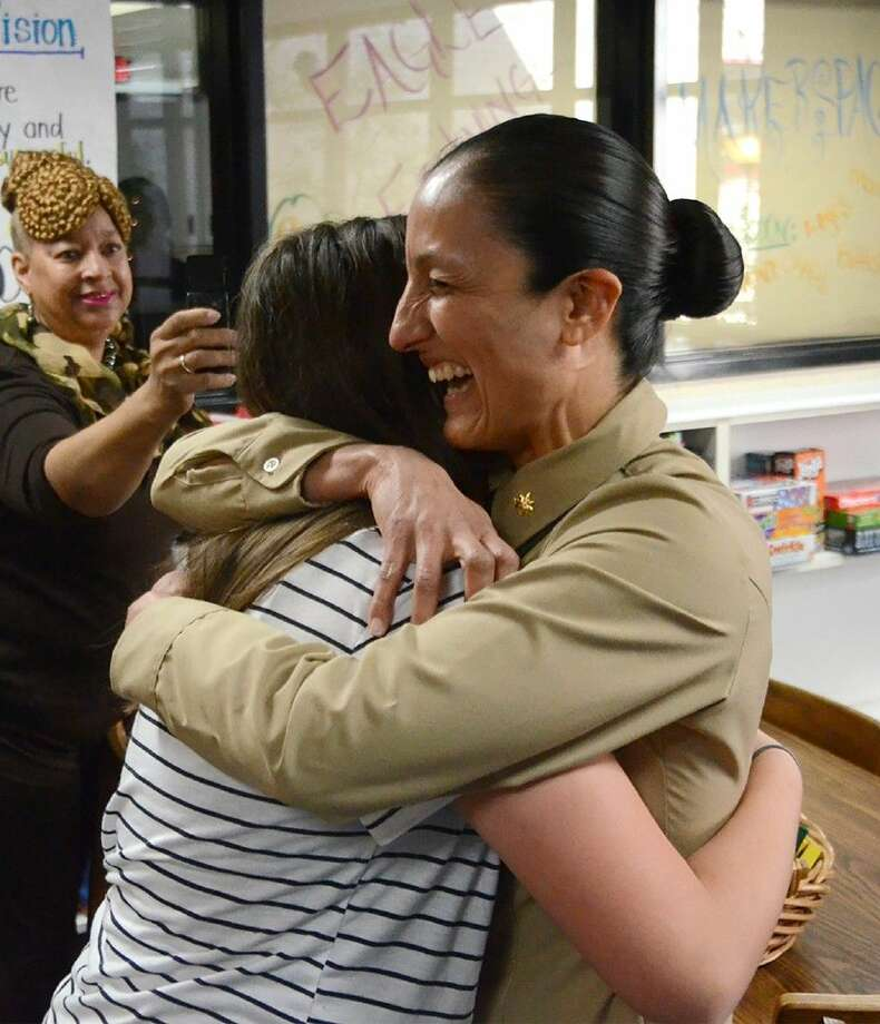 United States Marine Corps Major Paulina Rojas surprises her daughter, Labay Middle School seventh-grade student Francis Garza, at school on Nov. 10, a day before Veterans Day. Photo: Submitted Photo