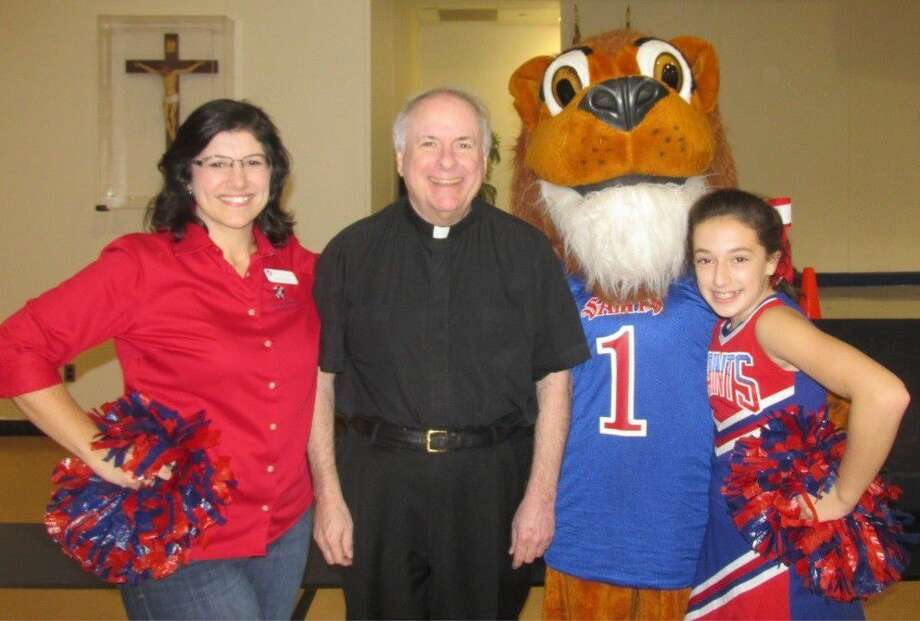 Debra Haney with Father Drew, St. Laurence Pastor, Leo the Lion School Mascot and student Sydney Jimenez. Photo: Submitted Photo