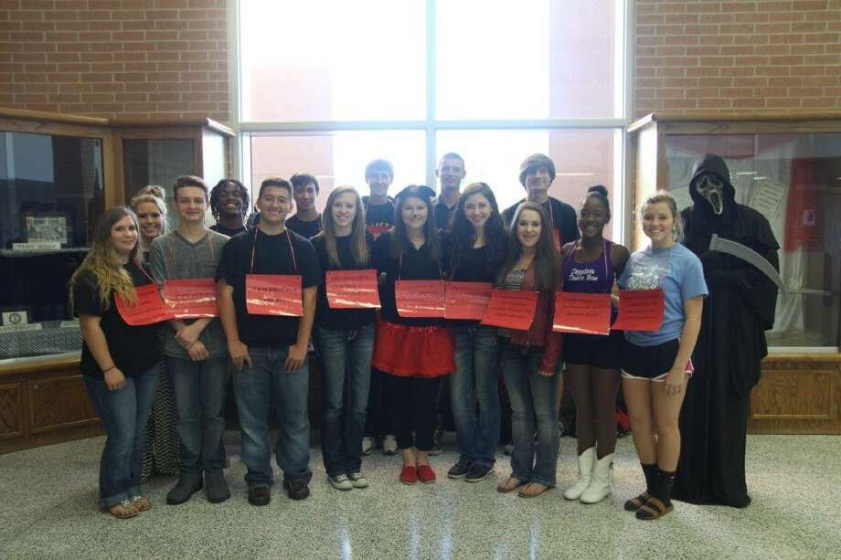 "Dayton High School students participating as ""victims"" of drug and alcohol-related deaths for Red Ribbon Week were (front row, left to right) Tiffany McCall, C.B. Teschendorf, Derek Marcontell, Shelby Eiland, Anna Etling, Brittney Lemon, Hayley Williams Khree Beechem, and Shelby Belt; (second row) Brett Smart, Keandre Rose, Joshua Eckerman, Dylan Cummings, Jayson Moffett and Wesley Till. Not pictured are Theran Fulton, Will McCracken, and D'Nel Waddell. Photo: Submitted"