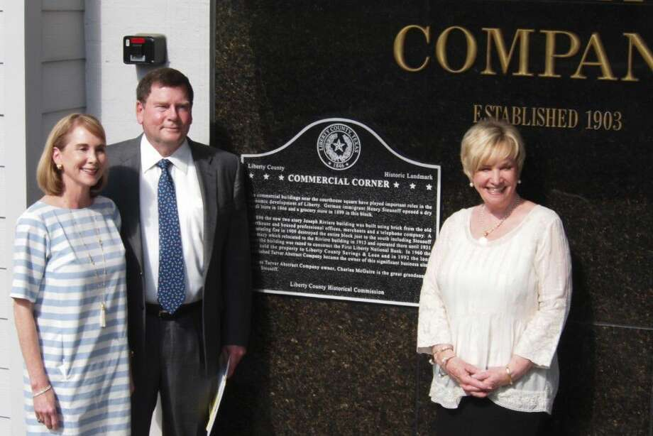 Unveiling the Liberty County Historical Commission marker placed on the Tarver Abstract Company building recognizing 400 Main Street in Liberty, Texas as Commercial Corner are Mary and Charles McGuire, at left, and Linda Jamison, chair of the historical commission. Photo: Casey Stinnett