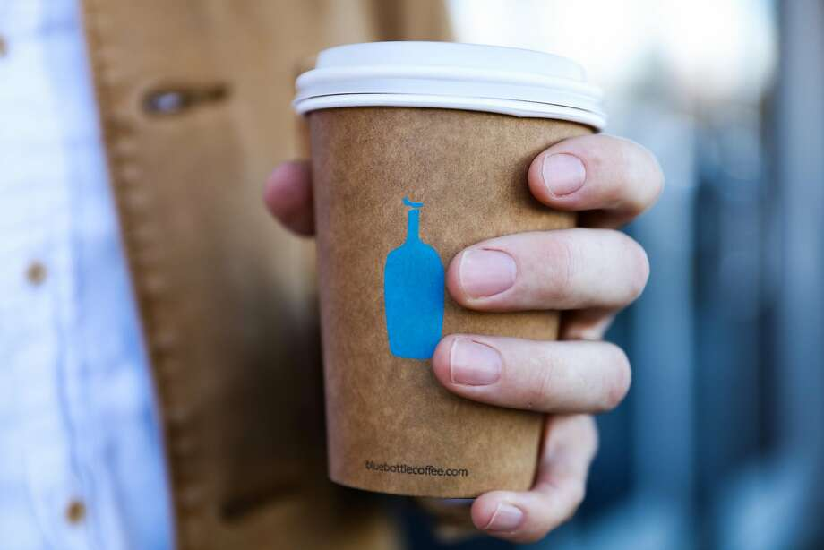 Miles Morris holds a cup of coffee on his way out of Blue Bottle Coffee in Oakland, California, on Tuesday, Oct. 4, 2016. Photo: Gabrielle Lurie, The Chronicle