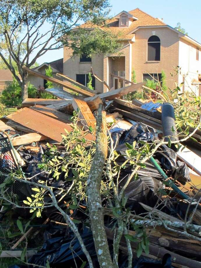 Tree limbs and storm debris lined the streets in a number of Friendswood neighborhoods after a tornado touched down Saturday. Photo: File Photo