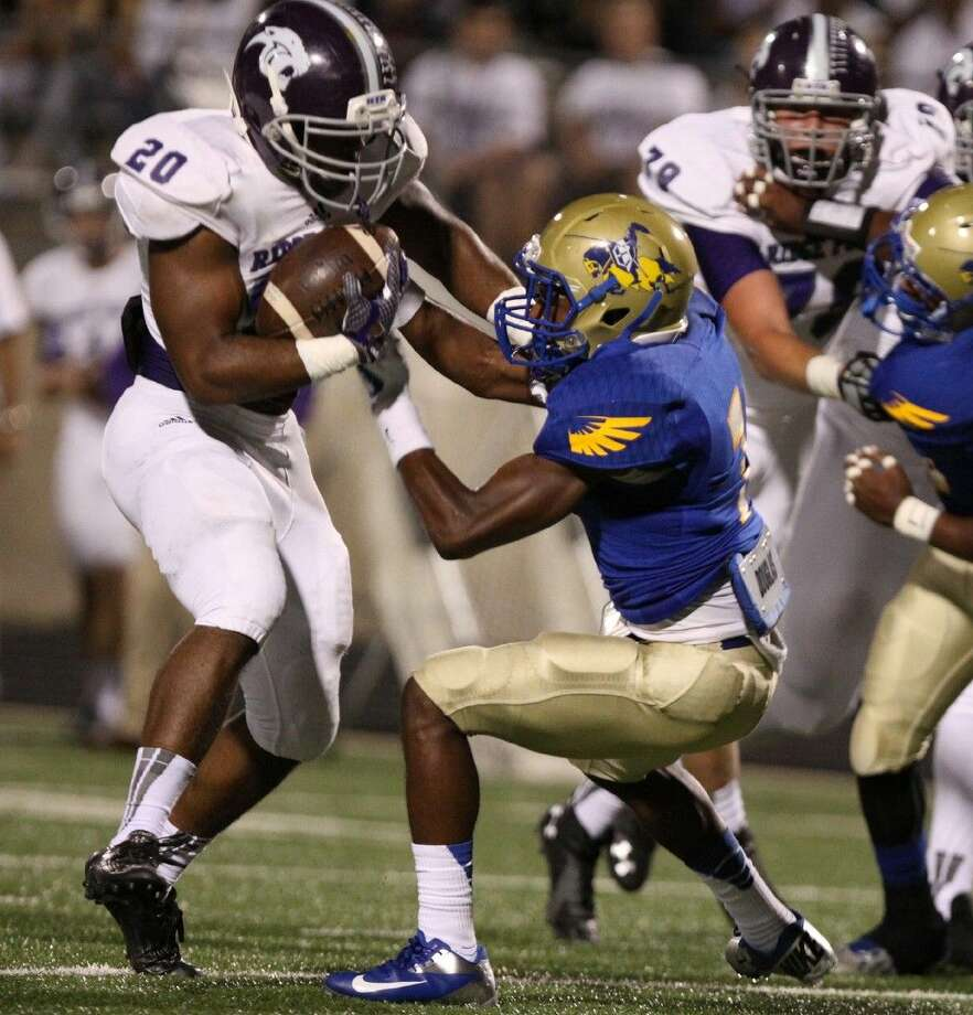 Elkins' Kadari Adams tries to bring down Ridge Point's KeShawn Ledet on Oct. 16 at Hall Stadium in Missouri City. To view or purchase this photo and others like it, go to HCNPics.com.