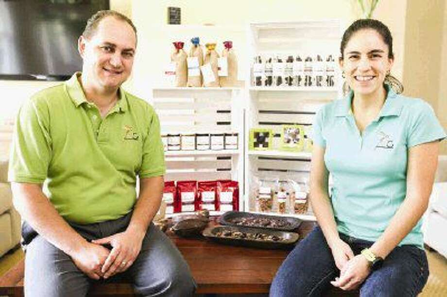 Lilian Vega and Fernando Guirola of Spring, founders of chocolate company Macaw Confections, are pictured with a few of their best-selling products. The couple sell their confections and coffees at The Woodlands Farmers Market, hosted Saturdays at the Grogan's Mill Village Center, and on Tuesdays at the Rice University Farmers Market.