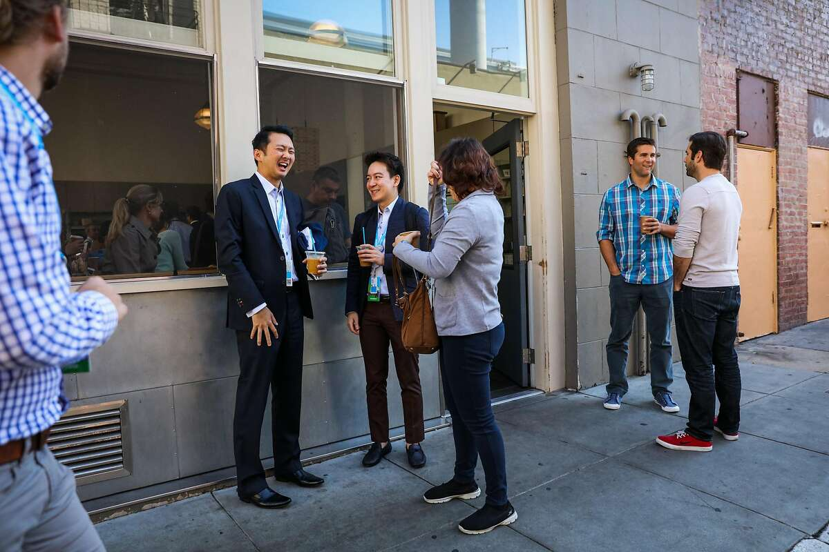 (second from left - right) Kevin Wee, Santi Ponvarin and Pimolpa Sunitchok stand outside Blue Bottle Coffee while enjoying their coffees, in San Francisco, California, on Tuesday, Oct. 4, 2016.