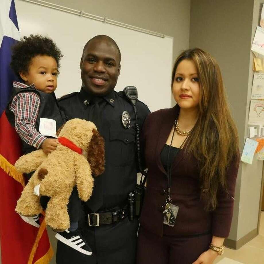 Officer Endy Ekpanya with Lucy Lugo and the couple's son, Julian Ekpanya.
