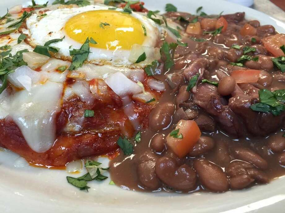 Red chile stacked flat enchiladas with a fried egg on top.
