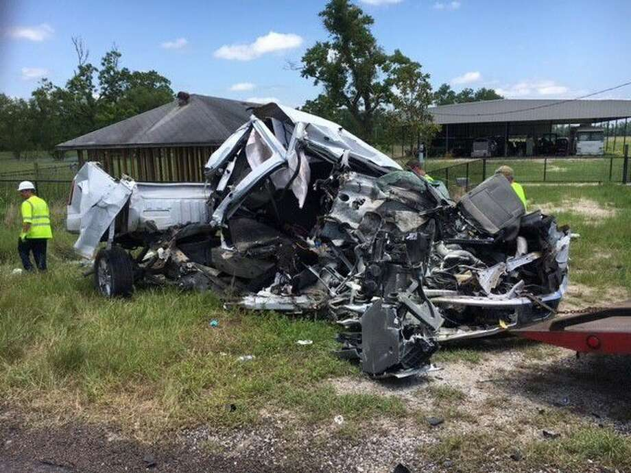 Two people were killed Friday morning in a three-vehicle accident about a half-mile east of Moss Hill on SH 105. Photo: Submitted