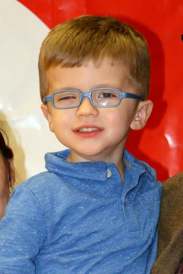 """Henry Friddle, diagnosed with retinoblastoma in April, is now believed to be cancer-free. He had one eye replaced with a prosthetic, which he calls his """"Hero Eye."""" Photo: Picasa"""
