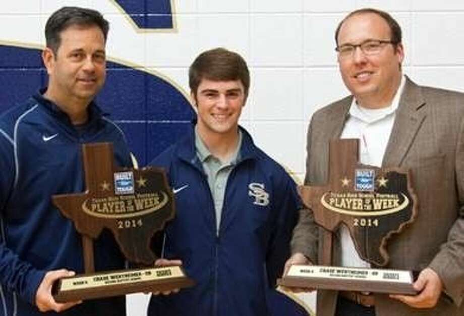 """On Friday, Nov. 7, at Second Baptist School, Brett Jordan of Sterling McCall Ford awarded Chase Wertheimer the """"Built Ford Tough Texas High School Football Player of the Week"""" trophy. Chase was recognized for his achievements on and off the field during Week 6 of the regular high school football season. From the left, Second Baptist head coach Terry Pirtle; Chase Wertheimer, Built Ford Tough Texas High School Football Player of the Week; and Brett Jordan, Sales Manager at Sterling McCall Ford show off the plaque that Wertheimer, who is a two-year starter, received."""
