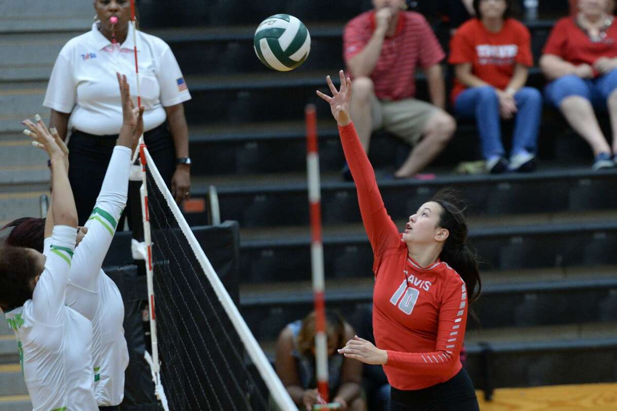 Travis' Audrey Phillips plays a ball at the net during the Lady Tigers' three-set victory against Hightower, Oct. 6 at Hightower High School. Travis improved to 8-3 in District 23-6A.