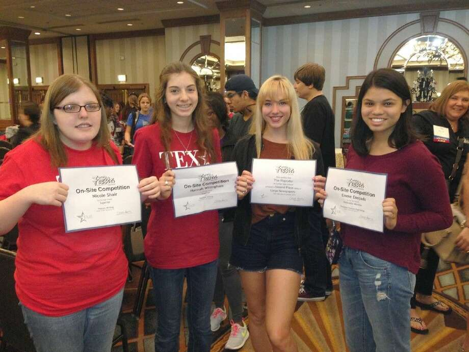 Cy-Fair High School students celebrate awards won at the TAJE Fall Festival, Oct. 17-19 in San Antonio. Pictured (L-R) are Nicole Shair (Superior, Feature Writing); Hannah Willingham (Superior, Headline Writing); Julie Ryza (holding 2014-2015 newspaper second-place Best of Show award); and Emme Enojado (Honorable Mention, Feature Page Design). Photo: Submitted Photo