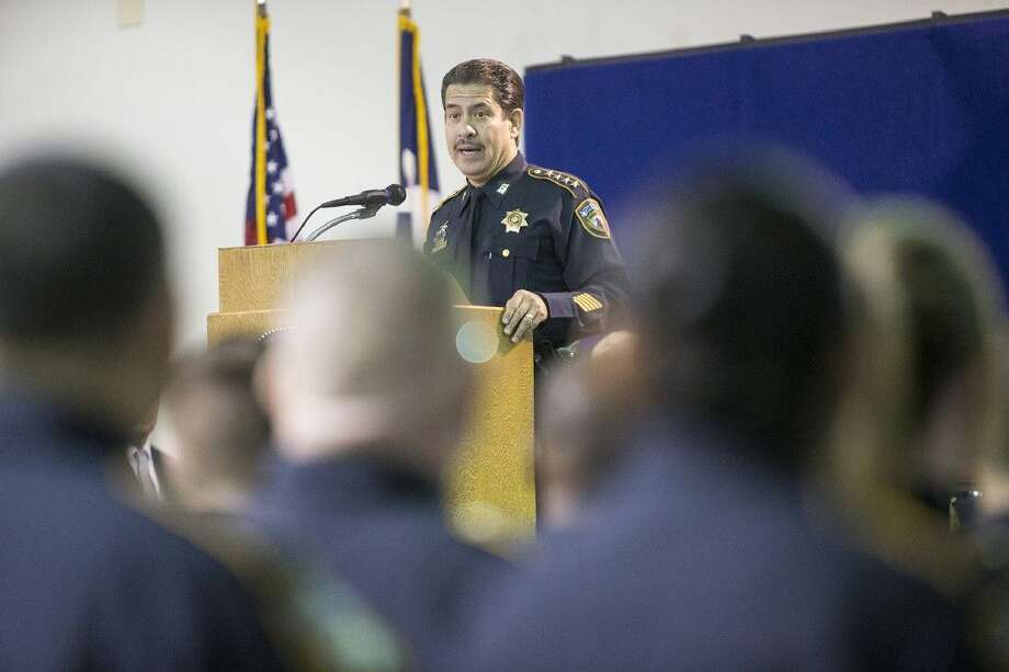 Sheriff Adrian Garcia address the graduates and their families during a graduation ceremony for 32 Harris County Sheriff's Office Academy cadets Nov. 21 at the HCSO Academy and Gun Range in Humble. Photo: ANDREW BUCKLEY