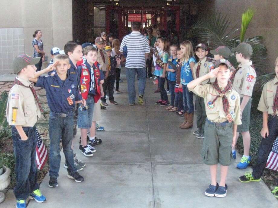 Pine Forest Elementary's Cub, Boy and Girl Scout troops welcomed guests and veterans to their annual Veterans Day Tribute Friday, Nov. 6, 2015.
