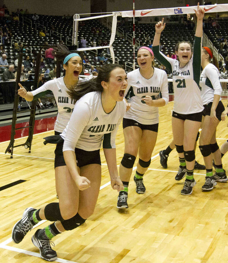 Clear Falls players celebrate after defeating Amarillo in straight sets to advance to the Class 6A finals of the UIL State Volleyball Championships at the Curtis Culwell Center in Garland Friday. To view or purchase this photo and others like it, visit HCNpics.com. Photo: Jason Fochtman