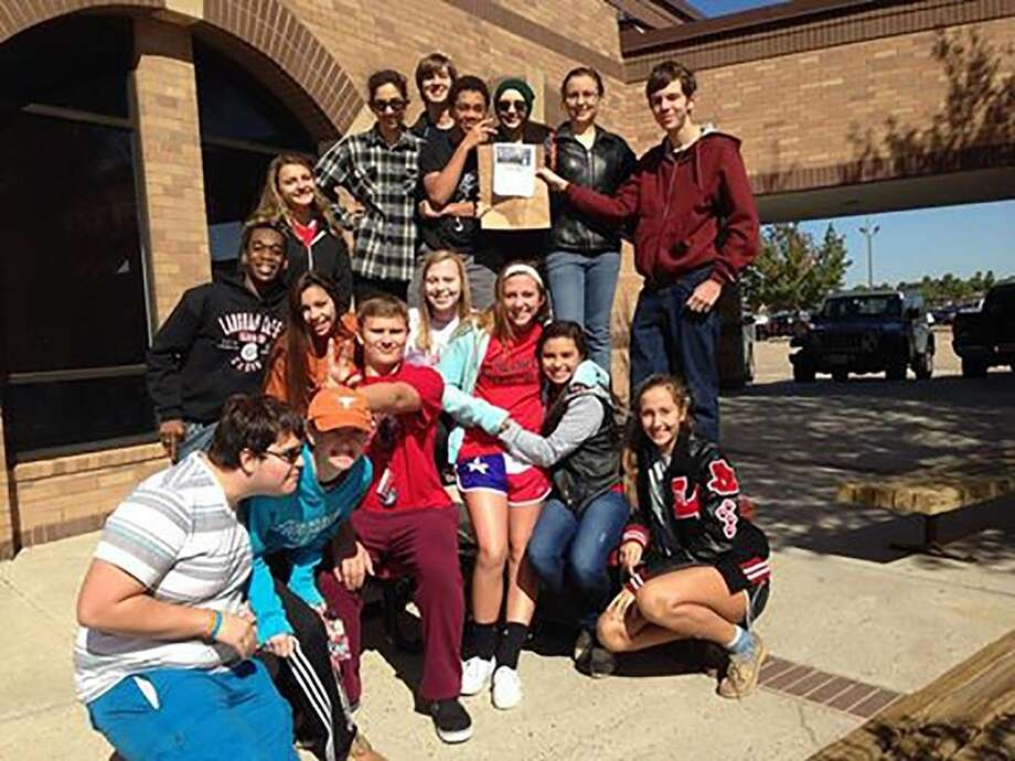 The Langham Creek theatre arts program collected nearly 1,000 pounds of food for the annual Trick or Treat so Kids Can Eat (TOTS-Eat) community service initiative through the International Thespian Society. Photo: Submitted Photo