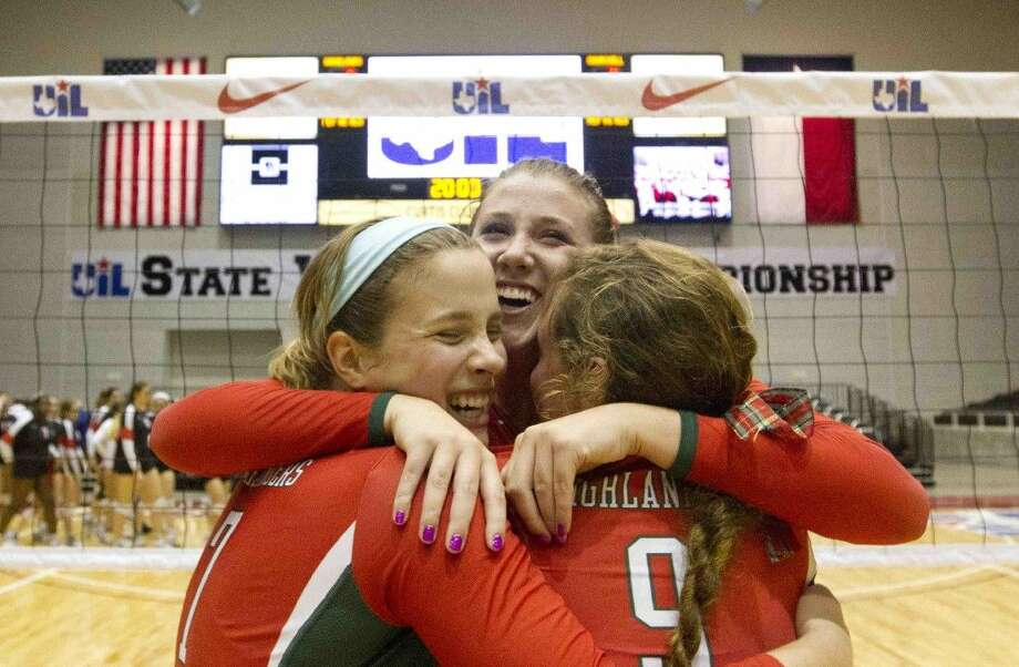 From left, The Woodlands' Hannah Hickman, Rachel Reed and Grey Kennedy celebrate after defeating San Antonio Churchill in five sets during a Class 6A state semifinal match in Garland.