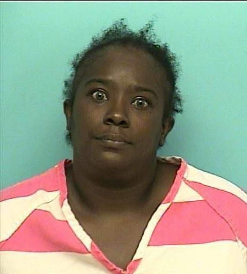 """SMITH, Paytonya GiawannBlack/Female DOB: 11-02-1975Height: 5'05"""" Weight: 220 lbs.Hair: Black Eyes: BrownWarrant: #130606689 Order of Arrest - Theft from Elderly IndividualLKA: N. 6th, Conroe."""