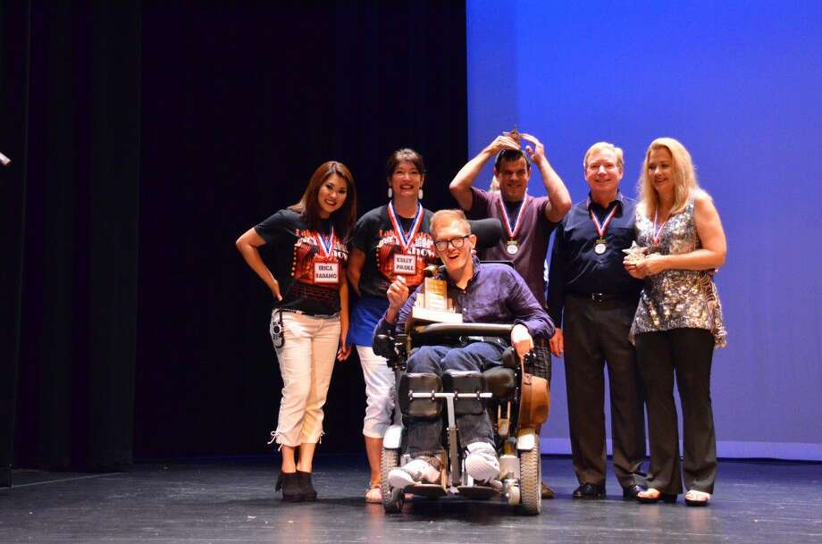 Erica Badamo and Kelly Paull pose with the winners of the 2015 Lake Houston's Got Talent Show.