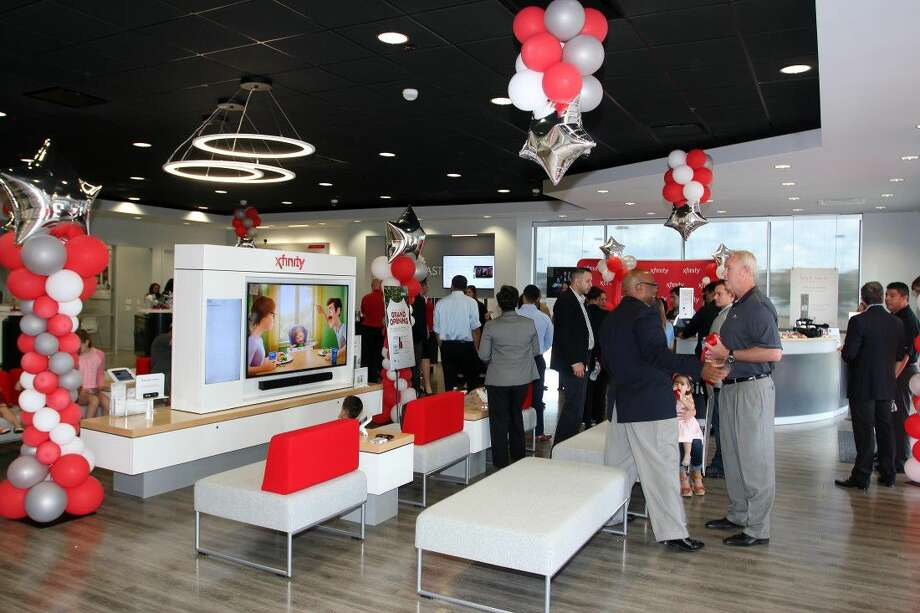 The new Comcast XFINITY location is large and offers many services for customers to pay their bill, ask questions, return equipment, resolve issues and experience the latest products and technologies. Photo: Kar B Hlava