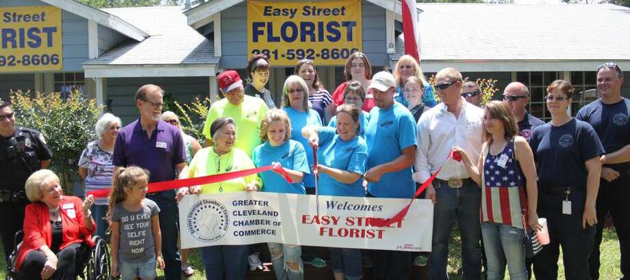 Sharla Bowen cuts the ribbon to Easy Street Florist during a ribbon cutting ceremony on June 14 when her business joined the Greater Cleveland Chamber of Commerce. Photo: Jacob McAdams